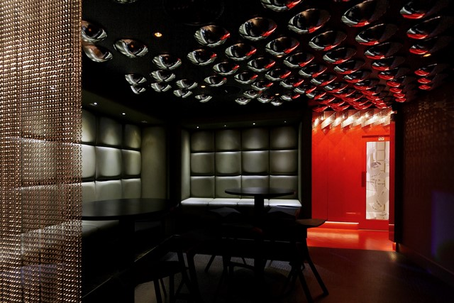 A karaoke venue comprising a bar a lounge and seven themed rooms. Partially obscured glazed doors allow glimpses into the rooms from a connecting corridor. & KARAOKE BOX · Hatterwan Architects Hatterwan Architects
